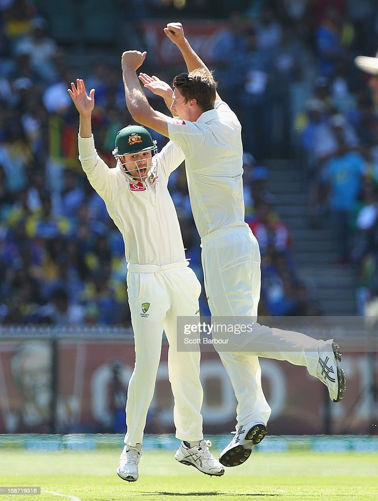 Jackson Bird of Australia celebrates with Ed Cowan after dismissing Dimuth Karunaratne of Sri Lanka during day one of the Second Test match between Australia and Sri Lanka at Melbourne Cricket Ground on December 26, 2012 in Melbourne, Australia.