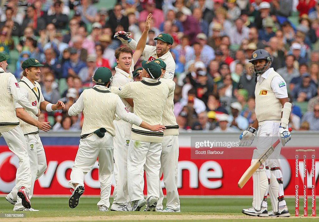Jackson Bird of Australia celebrates with his team mates after bowling Thilan Samaraweera of Sri Lanka during day three of the Second Test match...