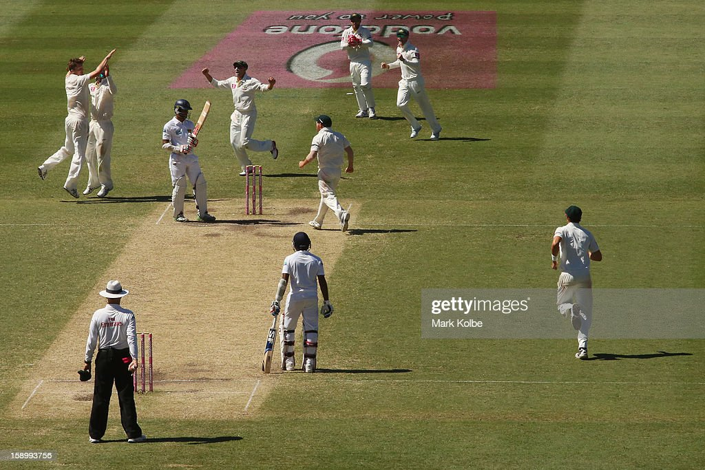 <a gi-track='captionPersonalityLinkClicked' href=/galleries/search?phrase=Jackson+Bird&family=editorial&specificpeople=8665256 ng-click='$event.stopPropagation()'>Jackson Bird</a> of Australia celebrates with his team mates after taking the wicket of Dimuth Karunaratne of Sri Lanka during day three of the Third Test match between Australia and Sri Lanka at Sydney Cricket Ground on January 5, 2013 in Sydney, Australia.