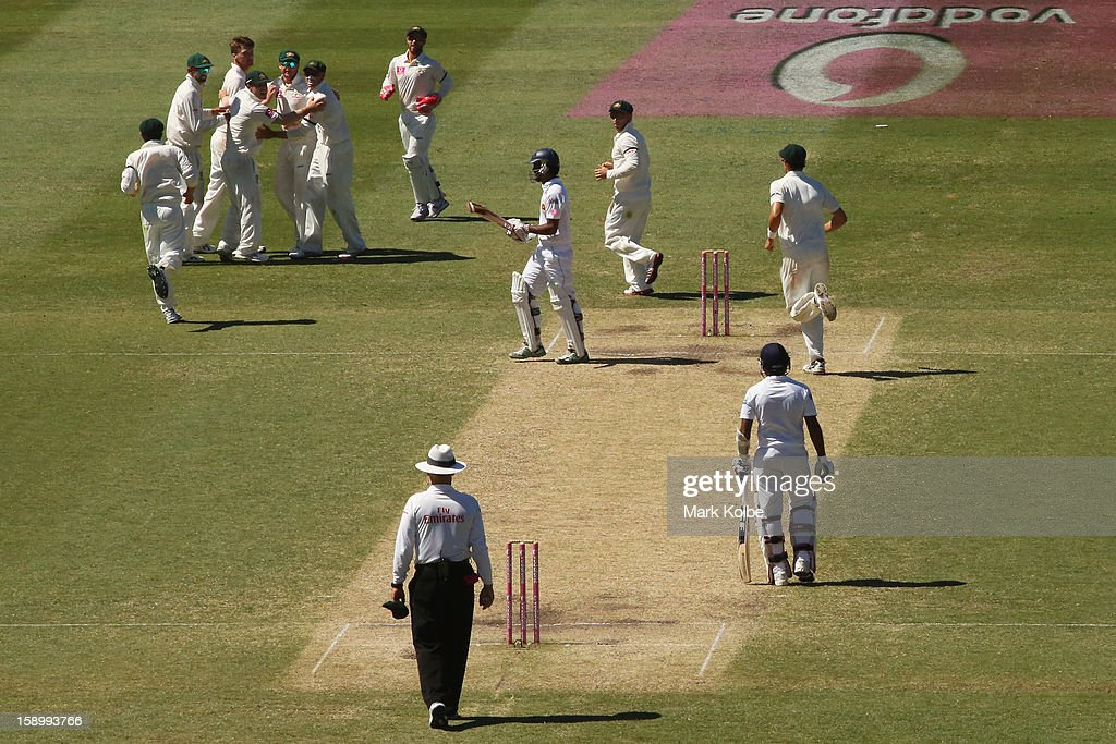 Jackson Bird of Australia celebrates with his team mates after taking the wicket of Dimuth Karunaratne of Sri Lanka during day three of the Third Test match between Australia and Sri Lanka at Sydney Cricket Ground on January 5, 2013 in Sydney, Australia.