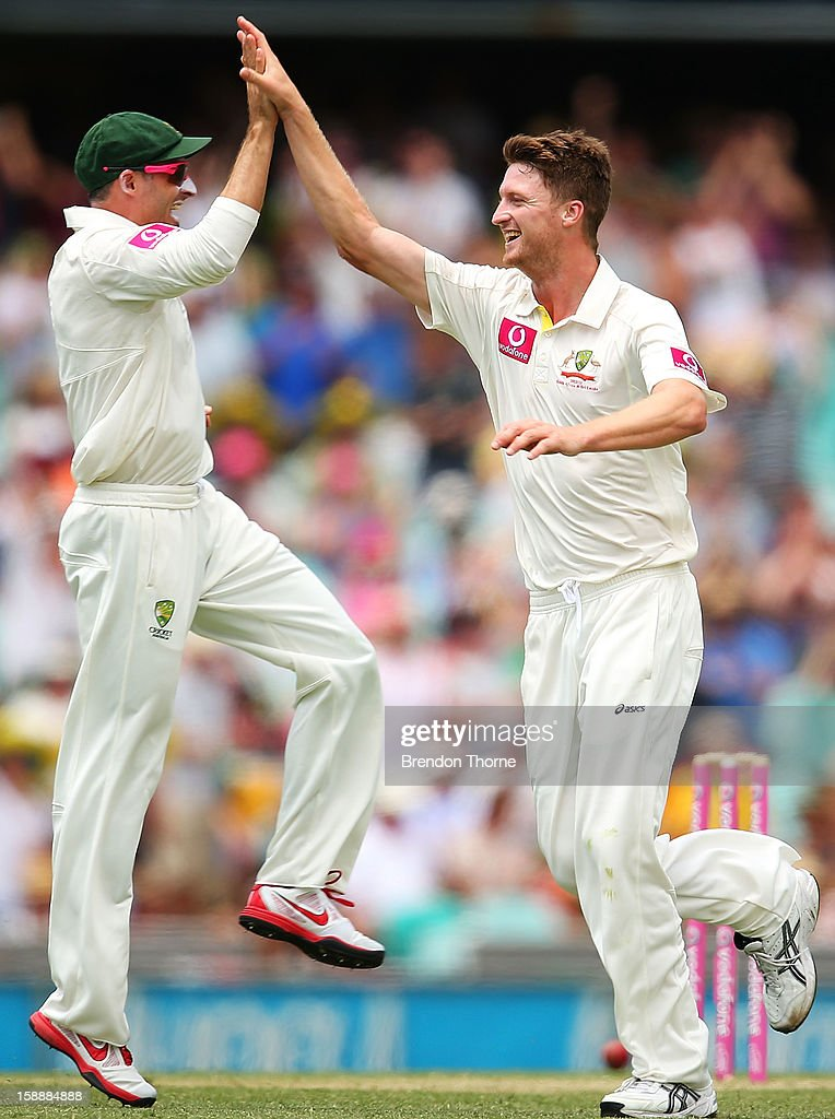 Jackson Bird of Australia celebrates with team mate Michael Hussey after claiming the wicket of Tillakaratne Dilshan of Sri Lanka during day one of the Third Test match between Australia and Sri Lanka at the Sydney Cricket Ground on January 3, 2013 in Sydney, Australia.