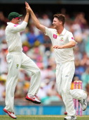 Jackson Bird of Australia celebrates with team mate Michael Hussey after claiming the wicket of Tillakaratne Dilshan of Sri Lanka during day one of...