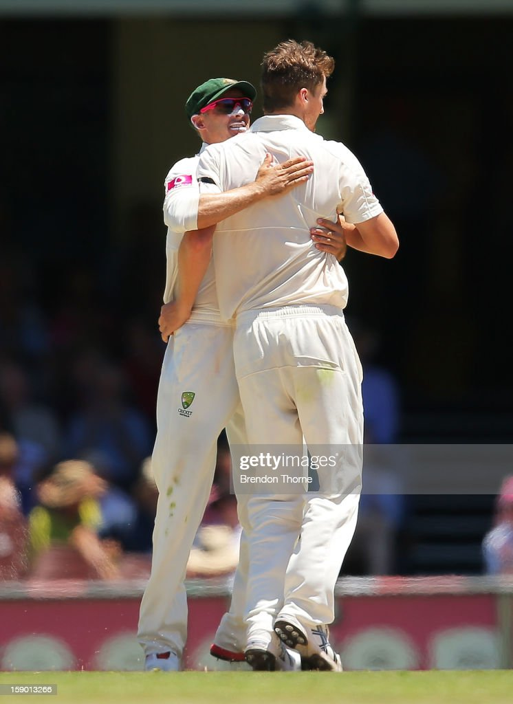 Jackson Bird of Australia celebrates with team mate Michael Hussey after claiming the wicket of Nuwan Pradeep of Sri Lanka during day four of the Third Test match between Australia and Sri Lanka at the Sydney Cricket Ground on January 6, 2013 in Sydney, Australia.