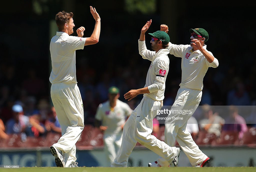 Jackson Bird of Australia celebrates with team mates after claiming the wicket of Rangana Herath of Sri Lanka during day four of the Third Test match between Australia and Sri Lanka at the Sydney Cricket Ground on January 6, 2013 in Sydney, Australia.