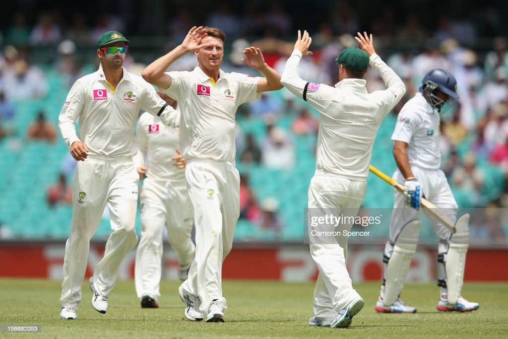 Jackson Bird of Australia celebrates with team mates after dismissing Tillakaratne Dilshan of Sri Lanka during day one of the Third Test match between Australia and Sri Lanka at the Sydney Cricket Ground on January 3, 2013 in Sydney, Australia.