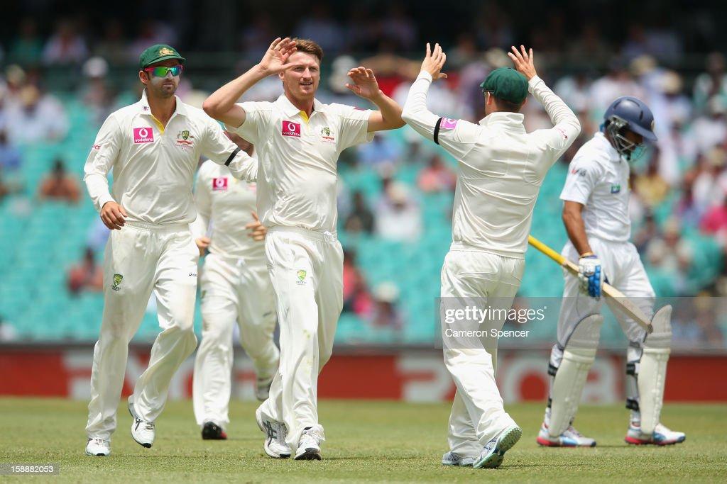 Jackson Bird of Australia celebrates with team mates after dismissing Tillakaratne Dilshan of Sri Lanka during day one of the Third Test match between Australia and Sri Lanka at the Sydney Cricket Ground on January 3, 2013 in Sydney, Australia.