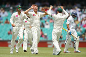Jackson Bird of Australia celebrates with team mates after dismissing Tillakaratne Dilshan of Sri Lanka during day one of the Third Test match...