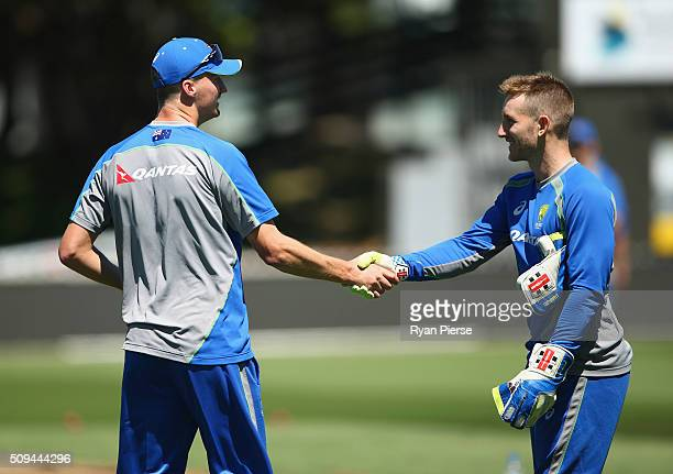 Jackson Bird of Australia is congratulated by Peter Nevill of Australia after being selected for the 1st Test during an Australian nets session at...