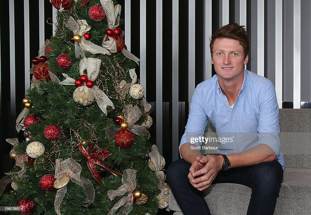 Jackson Bird of Australia poses next to a Christmas tree ahead of a Cricket Australia Christmas Day lunch at Crown Entertainment Complex on December 25, 2012 in Melbourne, Australia.