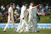 Jackson Bird of Australia raised the ball after finishing with five wickets during day four of the Test match between New Zealand and Australia at...