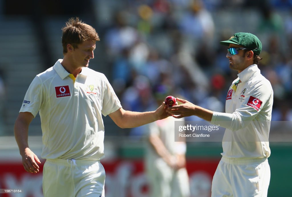 Jackson Bird of Australia takes the ball fron Nathan Lyon as he prepares to bowl during day one of the Second Test match between Australia and Sri Lanka at Melbourne Cricket Ground on December 26, 2012 in Melbourne, Australia.