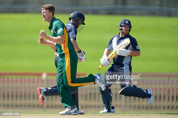 Jackson Bird of Tasmania celebrates after taking the wicket of Rob Quiney of Victoria during the Matador BBQs One Day Cup match between Tasmania and...
