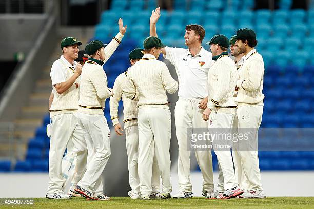 Jackson Bird of Tasmania celebrates with team mates after claiming the wicket of Shaun Marsh of Western Australia during day three of the Sheffield...