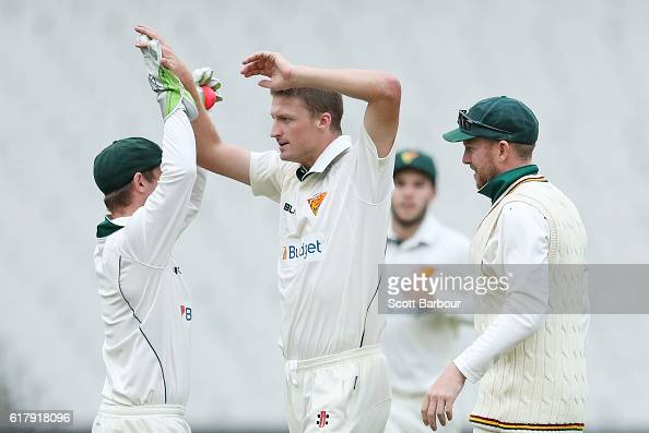 Jackson Bird of Tasmania celebrates with wicketkeeper Jake Doran after dismissing Aaron Finch of Victoria during day one of the Sheffield Shield...