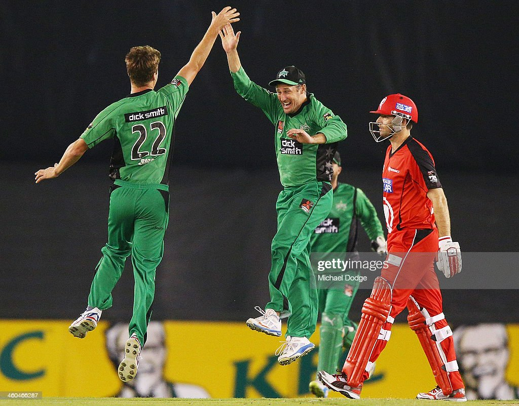 Jackson Bird (L) of the Stars celebrates his dismissal of Ben Rohrer of the Renegades with David Hussey during the Big Bash League match between the Melbourne Renegades and the Melbourne Stars at Etihad Stadium on January 4, 2014 in Melbourne, Australia.