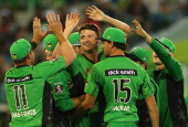 Jackson Bird of the Stars is congratulated by team mates after taking the wicket of Tom Cooper of the Renegades during the Big Bash League match...