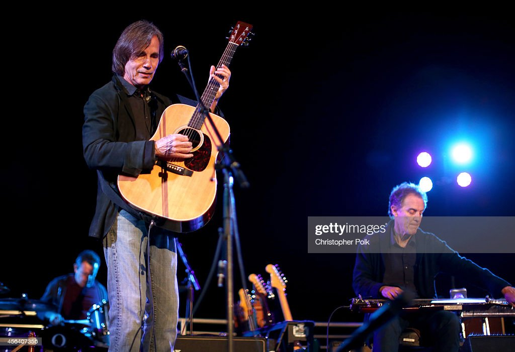 Jackson Browne performs at Rock4EB, Malibu, with Jackson Browne & David Spade sponsored by Suja Juice & Sabra Hummus at Private Residence on September 28, 2014 in Malibu, California.