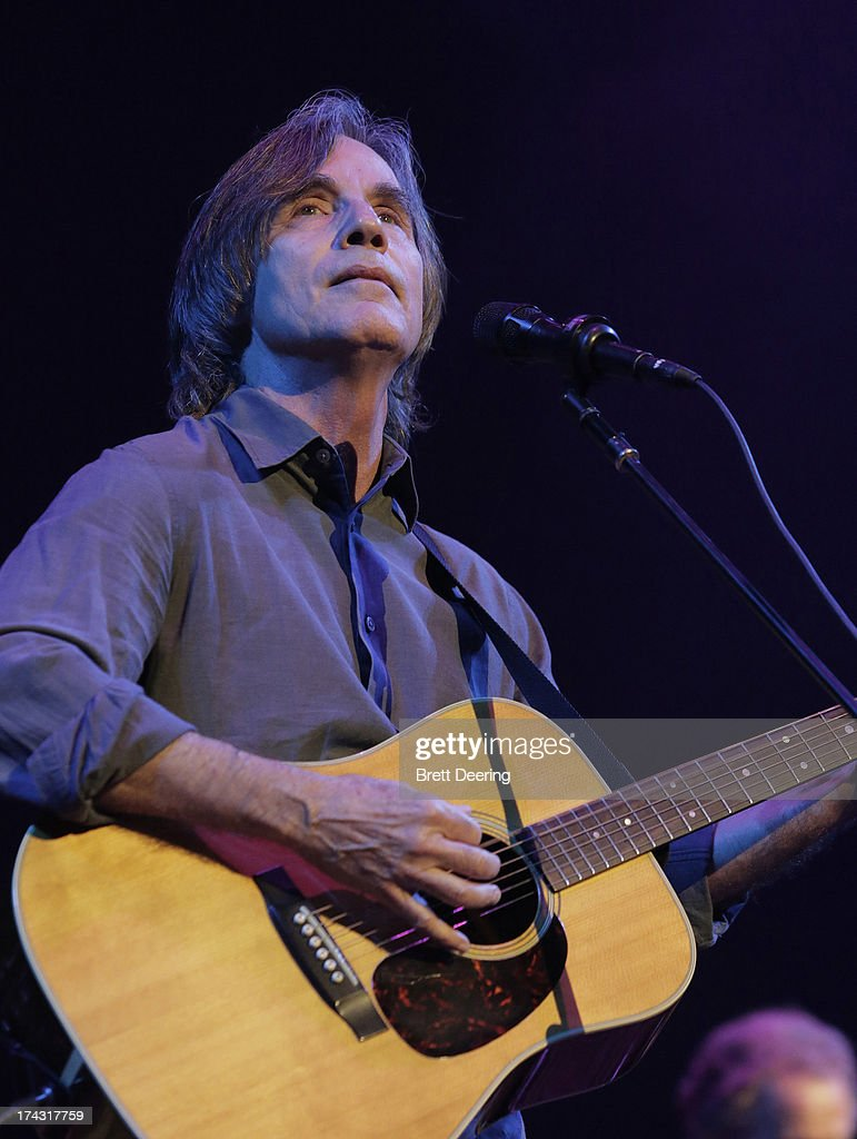 Jackson Browne performs during the Rock for Oklahoma Benefit at the Chesapeake Energy Arena on July 23, 2013 in Oklahoma City, Oklahoma.