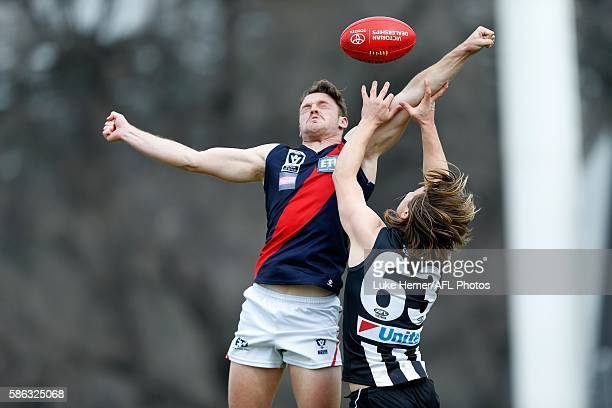 Jackson Clarke of Coburg spoils the mark of Gus Borthwick of Collingwood during the round 18 VFL match between Collingwood and Coburg at The Holden...