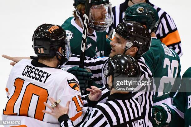 Jackson Cressey of the Princeton Tigers and Justin Baudry of the Bemidji State Beavers are broken up by referees after a little bit of shoving during...