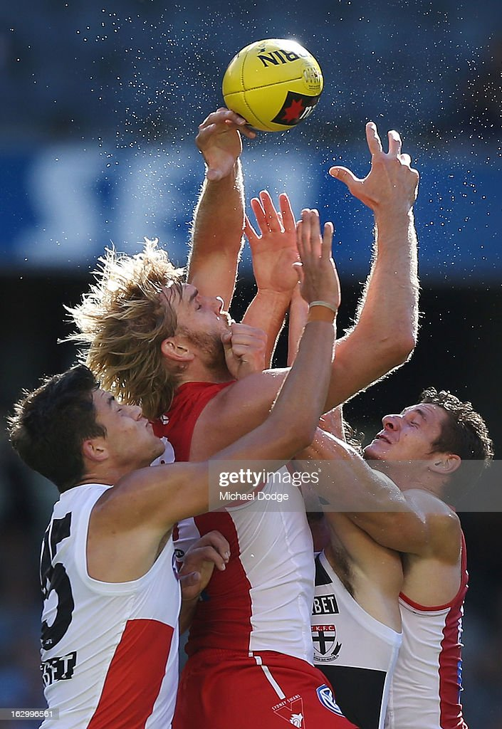 Jackson Ferguson (L) of the St.Kilda Saints contests for the ball against Lewis Roberts-Thompson (C) and Andrejs Everitt of the Sydney Swans during the round two AFL NAB Cup match between the St Kilda Saints and the Sydney Swans at Etihad Stadium on March 3, 2013 in Melbourne, Australia.