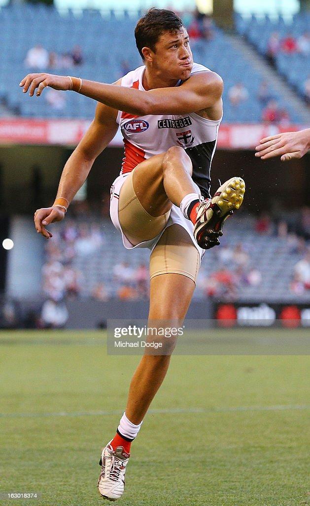 Jackson Ferguson of the St.Kilda Saints kicks the ball during the round two AFL NAB Cup match between the St Kilda Saints and the Sydney Swans at Etihad Stadium on March 3, 2013 in Melbourne, Australia.