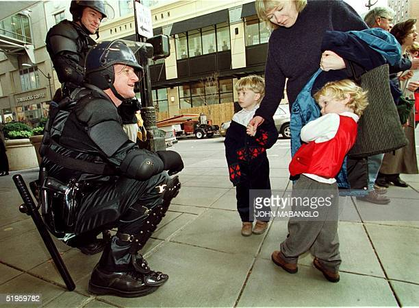 Jackson Gannon 2yearsold of SeattleWashington shys away from Washington State Trooper Dave Bourland and Greg Little 03 December as family friend Ian...
