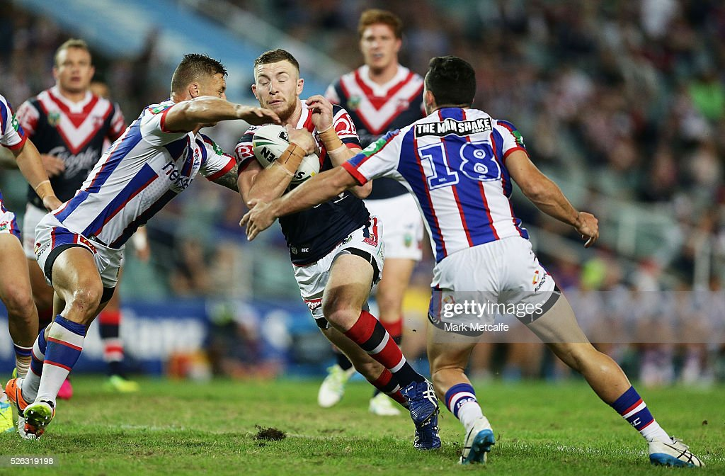 Jackson Hastings of the Roosters is tackled during the round nine NRL match between the Sydney Roosters and the Newcastle Knights at Allianz Stadium on April 30, 2016 in Sydney, Australia.