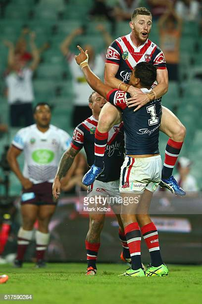Jackson Hastings of the Roosters jumps on Latrell Mitchell of the Roosters as he celebrates scoring a try only to have it disallowed by the video...