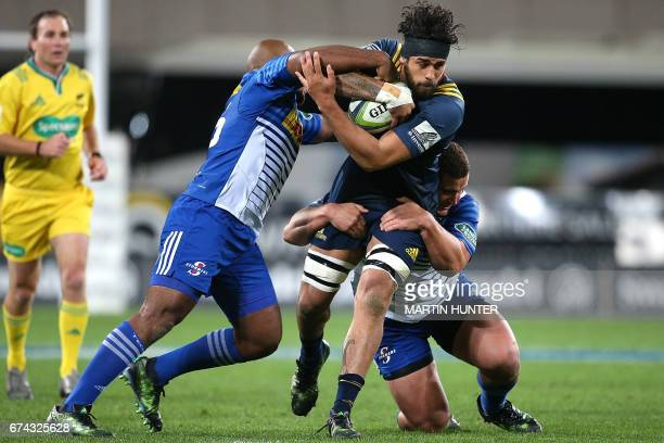 Jackson Hemopo of the Otago Highlanders is tackled during the Super Rugby match between the Otago Highlanders of New Zealand and the Western Stormers...