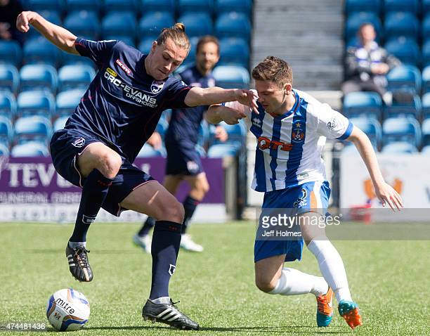 Jackson Irvine in action for Ross County holds off Greg Kiltie of Kilmarnock during the Scottish premiership match between Kilmarnock and Ross County...