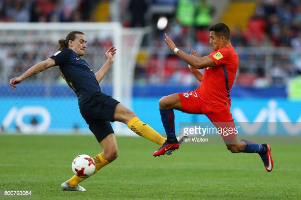 Jackson Irvine of Australia and Alexis Sanchez of Chile battle for possession during the FIFA Confederations Cup Russia 2017 Group B match between...