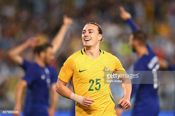 Jackson Irvine of Australia celebrates Tim Cahill scoring a goal only to have it disallowed during the international friendly match between the...