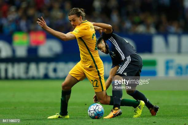Jackson Irvine of Australia controls the ball under pressure of Hotaru Yamaguchi of Japan during the FIFA World Cup Qualifier match between Japan and...