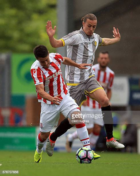 Jackson Irvine of Burton Albion and Bojan Krkic of Stoke City battle for the ball during the Pre Season Friendly match between Burton Albion and...