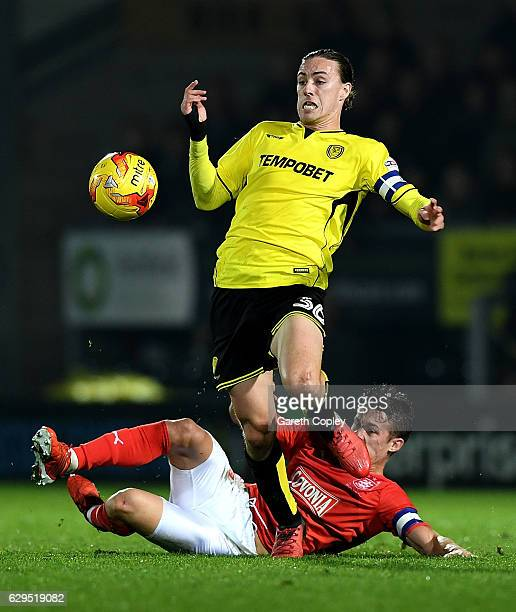 Jackson Irvine of Burton Albion is tackled by Jonathan Hogg of Huddersfield during the Sky Bet Championship match between Burton Albion and...