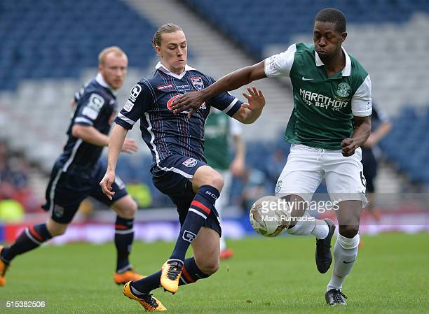 Jackson Irvine of Ross County challenges Marvin Bartley of Hibernian during the Scottish League Cup Final between Hibernian FC and Ross County FC at...