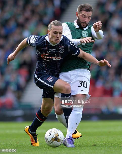 Jackson Irvine of Ross County is tackled by Kevin Thomson of Hibernian during the Scottish League Cup Final between Hibernian FC and Ross County FC...