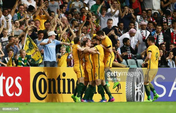 Jackson Irvine of the Socceroos celebrates with team mates after scoring the first goal during the 2018 FIFA World Cup Qualifier match between the...