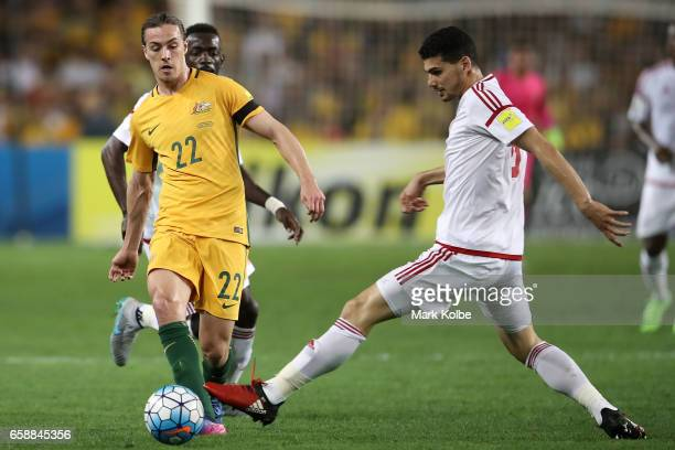 Jackson Irvine of the Socceroos passes under pressure from Ismail Ahmed of the United Arab Emirates during the 2018 FIFA World Cup Qualifier match...