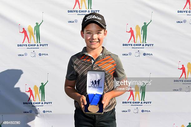 Jackson Koivun poses with his medal after winning the Drive competition in the Boys 1011 yr old division during the Drive Chip and Putt regional...