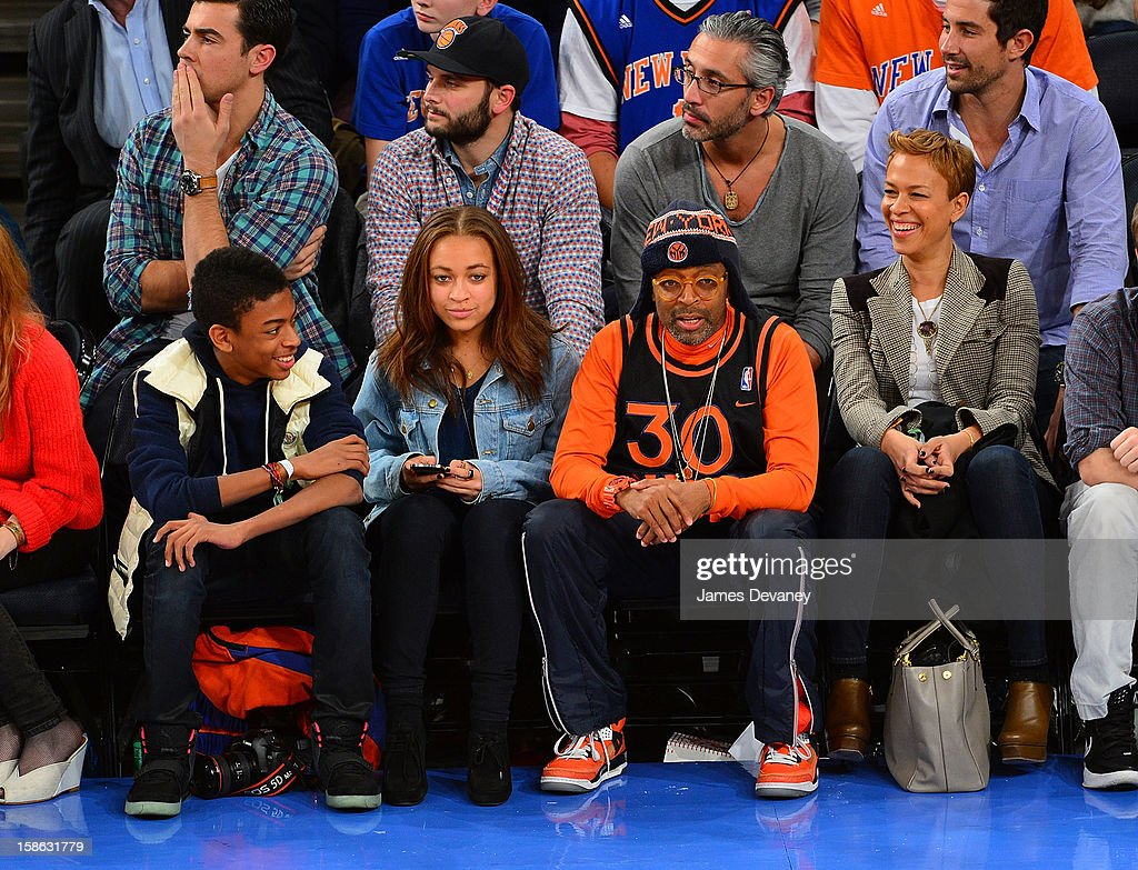 Jackson Lee, Satchel Lee, Spike Lee and Tonya Lewis attend the Chicago Bulls vs New York Knicks game at Madison Square Garden on December 21, 2012 in New York City.