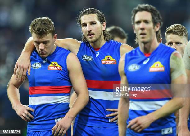 Jackson Macrae Marcus Bontempelli and Robert Murphy of the Bulldogs look dejected after losing the round nine AFL match between the Geelong Cats and...
