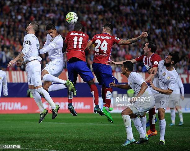 Jackson Martinez of Club Atletico de Madrid goes for a high ball against Rafael Varane of Real Madrid during the La Liga match between Club Atletico...