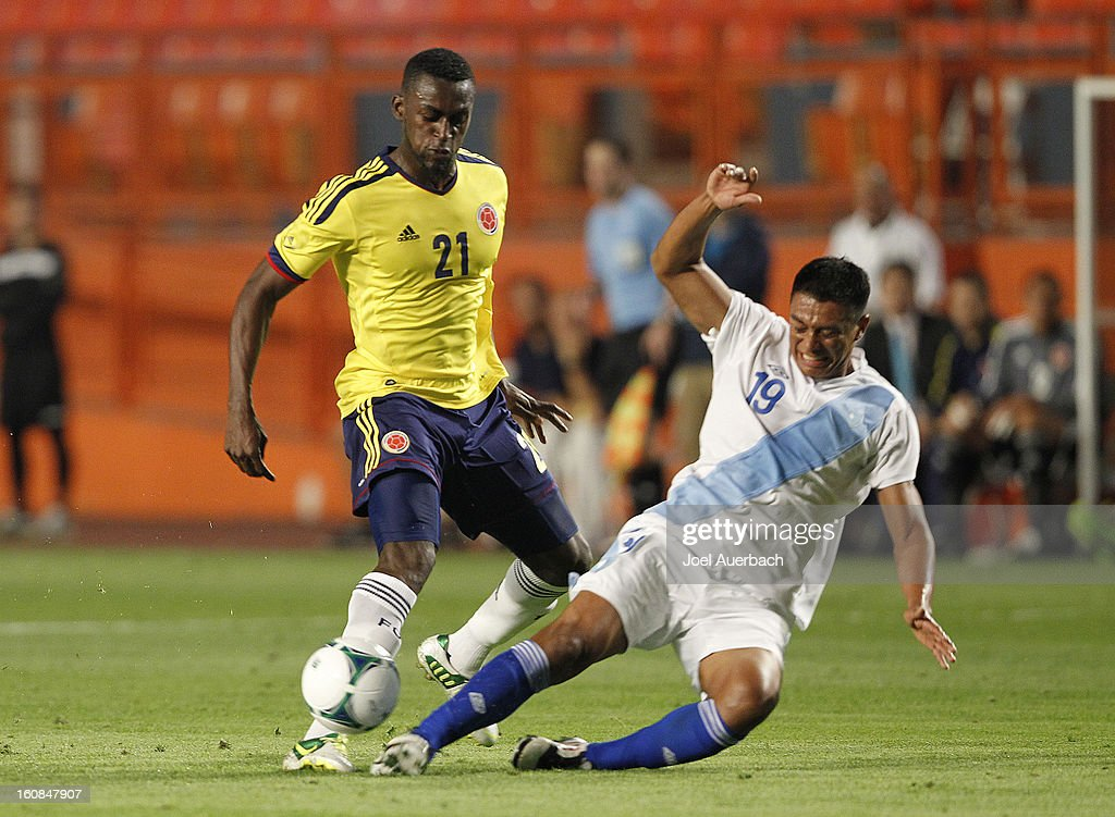 Jackson Martinez #21 of Colombia and Carlos Castrillo #19 of Guatemala battle for control of the ball on February 6, 2013 at SunLife Stadium Stadium in Miami Gardens, Florida.