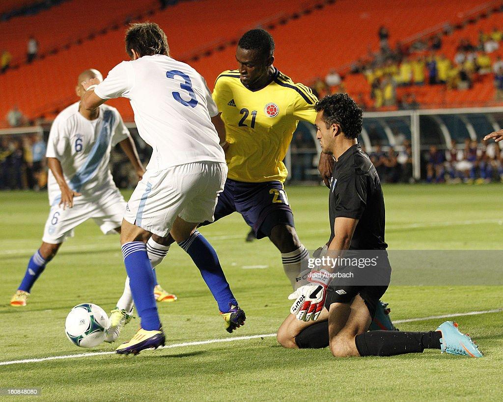 Jackson Martinez #21 of Colombia attacks as Elias Vasquez #3 assists goalkeeper Ricardo Jerez, Jr. #1 of Guatemala defend the net on February 6, 2013 at SunLife Stadium Stadium in Miami Gardens, Florida.