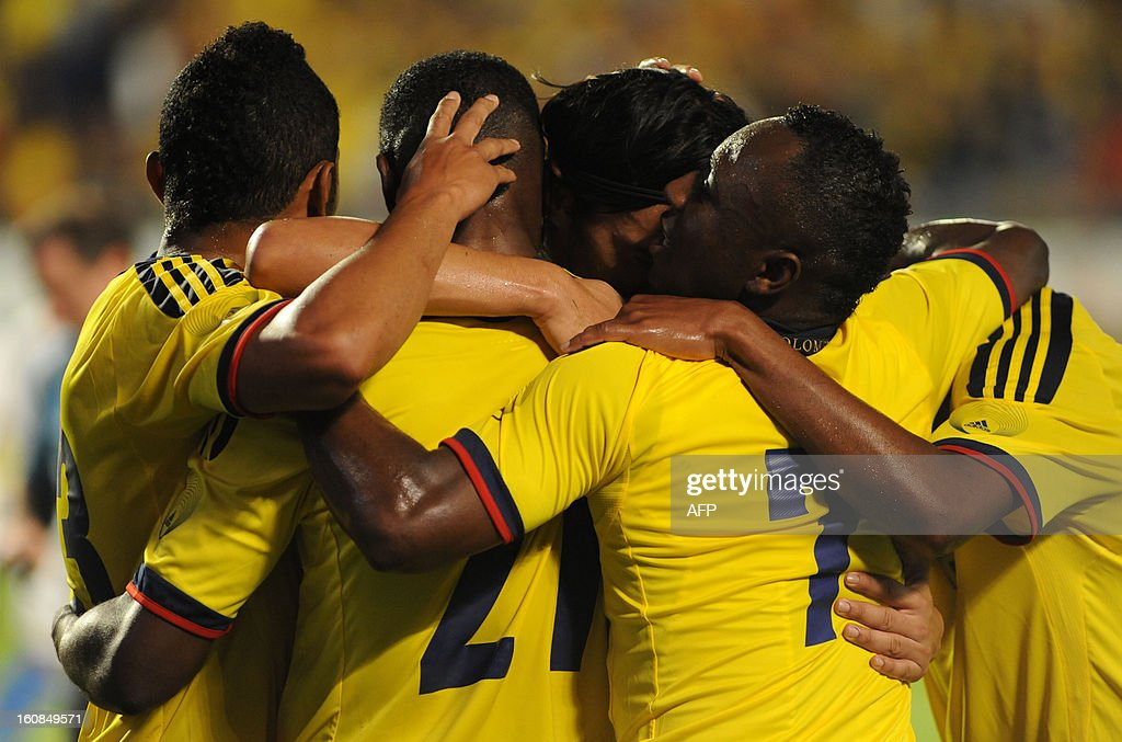 Jackson Martinez #21 of Colombia celebrates with teammates after scoring a second goal in the first half against Guatemala at Sun Life Stadium on February 6, 2013 in Miami, Florida. AFP PHOTO / Gaston de Cardenas