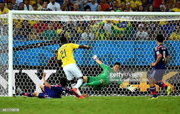 Jackson Martinez of Colombia scores his team's second goal past Eiji Kawashima of Japan during the 2014 FIFA World Cup Brazil Group C match between...