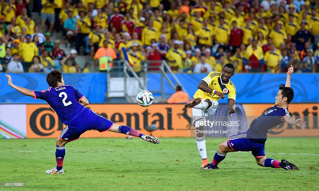 Jackson Martinez of Colombia shoots and scores his team's third goal during the 2014 FIFA World Cup Brazil Group C match between Japan and Colombia at Arena Pantanal on June 24, 2014 in Cuiaba, Brazil.