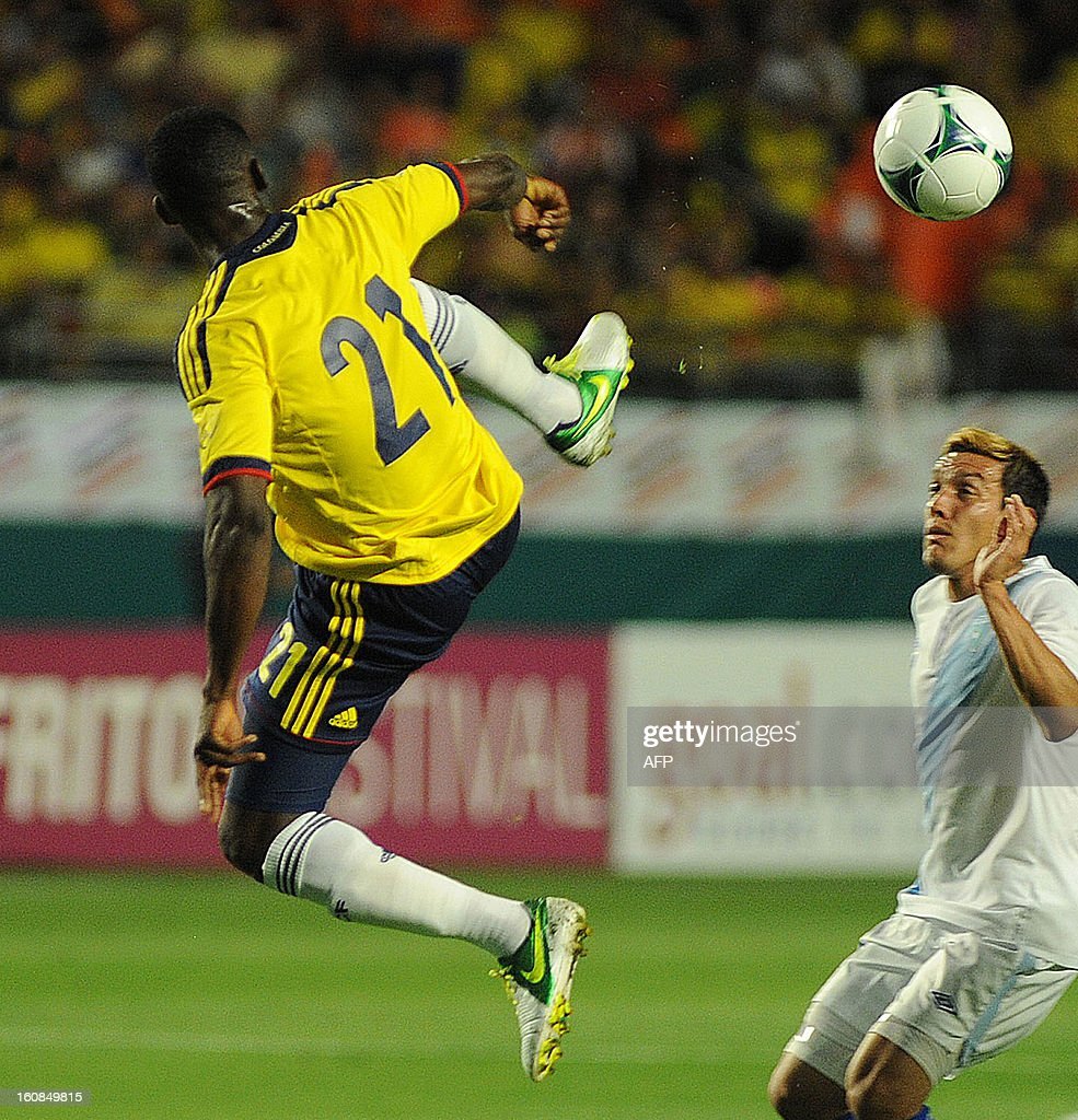 Jackson Martinez #21 of Colombia (L) vies for the ball against Mario Rodriguez #11 of Guatemala (R) at Sun Life Stadium on February 6, 2013 in Miami, Florida. AFP PHOTO / Gaston de Cardenas